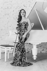 Elegant european or american woman in fashionable dark evening long dress, clothes theme ,concept lifestyle