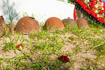 Soviet military helmets with flowers as memory of fallen soldiers during World War II