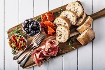 Italian antipasti with mediterranean olives, parma ham