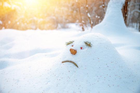 Sad snowdrift, snowman, in anticipation of spring
