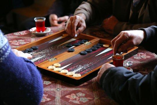 people playing backgammon