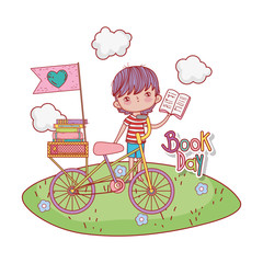 happy little boy reading book with bicycle in the field