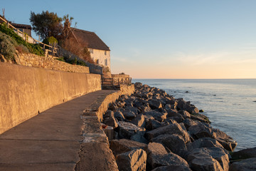 Thatched cottage and new sea defences at Runswick Bay near Whitby