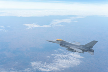 The F-16 aircraft flew through the atmosphere