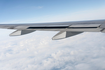 Plane wings are in the atmosphere
