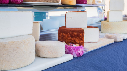 Different types of goat cheese in the market of Teguise in Lanzarote