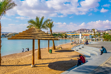 EILAT, ISRAEL, DECEMBER 30, 2018: People are enjoying a sunny day on a beach in Eilat, Israel