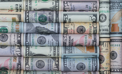 Background of the different  American dollar bills in rolls.