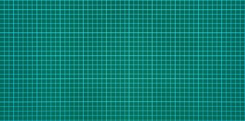 Green craft cutting mat clean new surface, closeup background.