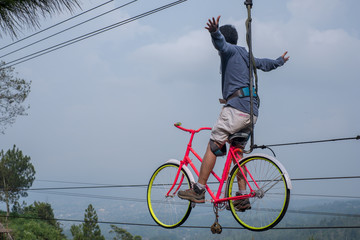 man riding a bike on sky air