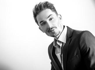 Handsome young elegant man in jacket. Black-white portrait.