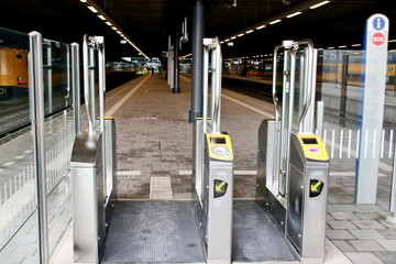 Controll tourniquettes for cards check in and out for public transportation in the hague central station