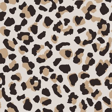 Abstract leopard skin seamless pattern. Animal fur wallpaper.