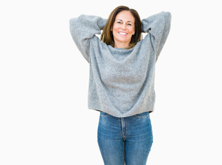 c3ca4f95a3001 Beautiful middle age woman wearing winter sweater over isolated background  Relaxing and stretching with arms and