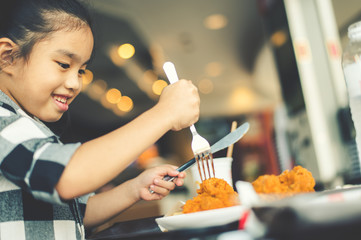 Asian Children Eating Fried Chicken Food Court