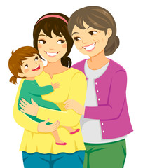 Happy mother, daughter and granddaughter standing together.