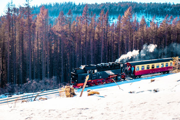 Train in Harz mountains in the snow during winter at Schierke Germany, Steam engined trains in harz national park germany