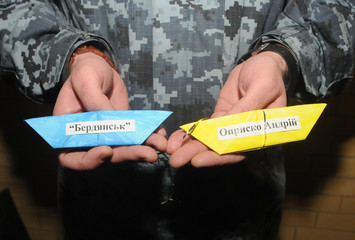 "Paper boats with the inscription ""Berdyansk"" and ""Oprisko Andrew"" at a charity exhibition in support of sailors of prisoners of war, in Kiev, February 23, 2019"