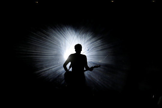 Israeli musician Dudu Tassa is silhouetted as he performs at a club in Tel Aviv