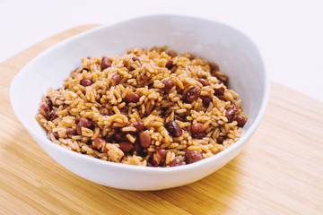 Rice and Beans in White Bowl on Wooden Surface