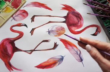 Watercolor drawing of flamingo bird, palette, watercolor paints, artistic brushes