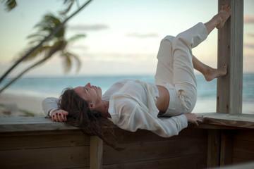 Dreamy girl pose on tropical beach
