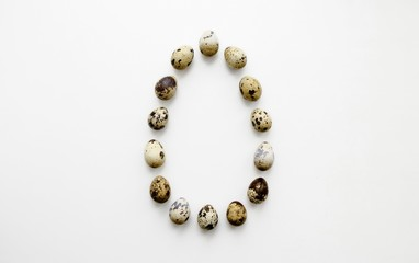 Quail eggs are on a white background there is a place for an inscription