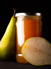 Pear jam and fresh yellow ripe pears
