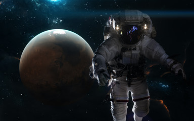 Planet Mars and astronaut. Solar system, nebulae, star clusters. Science fiction art. Elements of the image were furnished by NASA