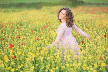 curly haired woman in the poppy meadow