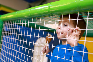 Child behind net