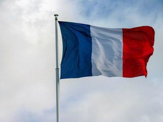 Very nice French Tricolour fabric flag waving in the wind
