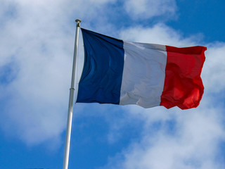 French fabric Tricolour: flag of France flapping in the wind with copy space