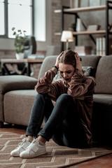 Teenage girl having strong headache after big depression