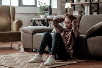 Teenage girl feeling depressed after breakup with boyfriend