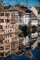Symmetric reflection in the water of old timber-framed houses