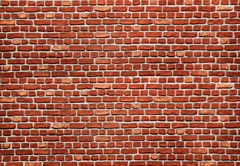 Bright red brick wall with big and small blocks and white seams. Brick wall texture background.