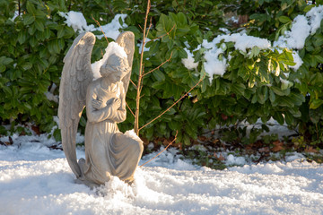 sculpture of praying angel on grave at municipal cemetery in Amsterdam, The Netherlands