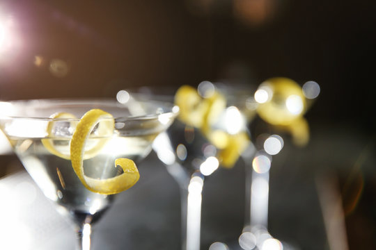 Glasses of lemon drop martini cocktail in bar, closeup. Space for text