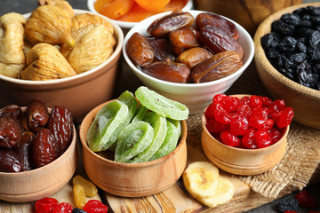 Bowls with different dried fruits on table. Healthy food
