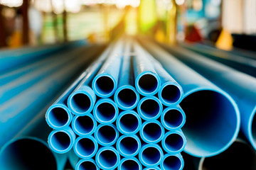 Close up to blue plastic pipe background, PVC pipes stacked in warehouse,  PVC water pipes used for construction