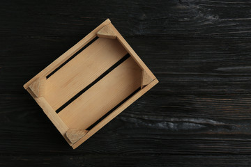 Empty wooden crate on dark background, top view with space for text