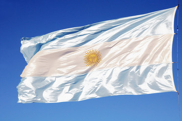 Argentinean flag on the bue sky background.