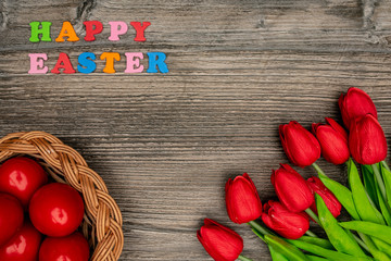 Easter eggs and red tulips