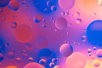 oily drops  in water with colorful background, close-up