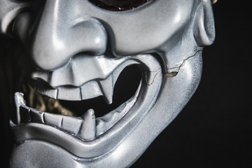 Japanese oni mask or giant mask, used to decorate handmade from original to make it look dark and art, closeup at broken point