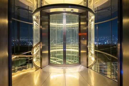 Glass modern elevator cylindrical shape