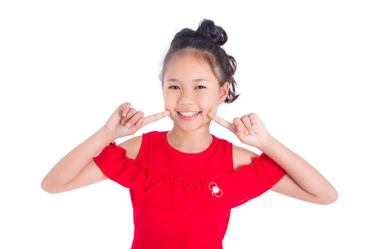 Cute teenager asian girl smiling over white background
