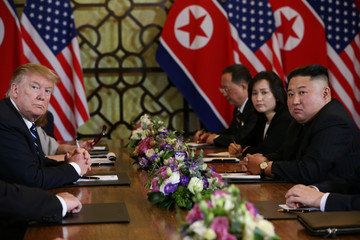 North Korea's leader Kim Jong Un and U.S. President Donald Trump look on at the extended bilateral meeting in the Metropole hotel during the second North Korea-U.S. summit in Hanoi