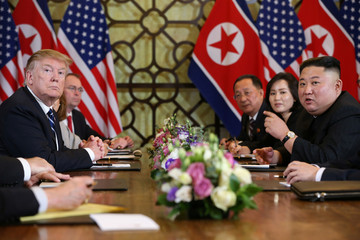 North Korea's leader Kim Jong Un speaks as U.S. President Donald Trump looks on during the extended bilateral meeting in the Metropole hotel during the second North Korea-U.S. summit in Hanoi